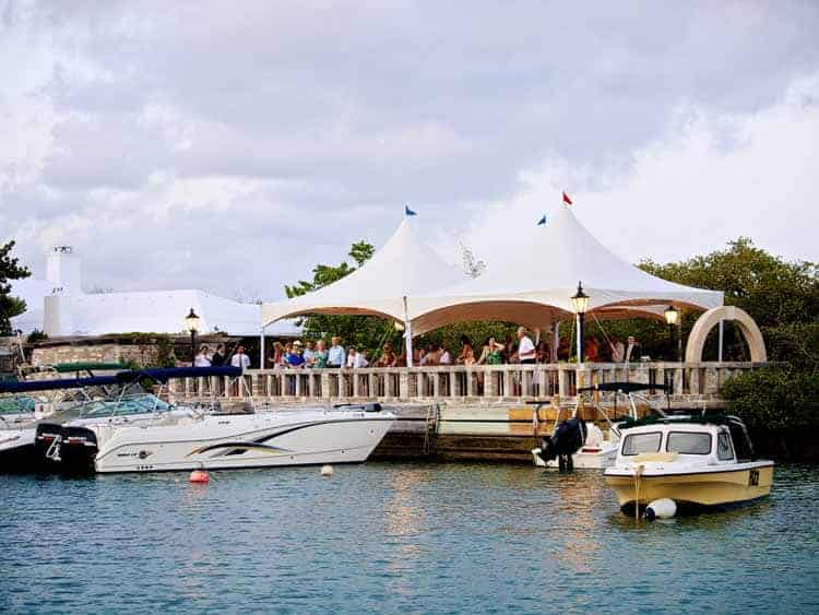 Boats at the dock of Tom Moore's Tavern in Bermuda