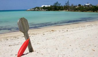 View of the sand and ocean at Shelly Bay Beach in Bermuda