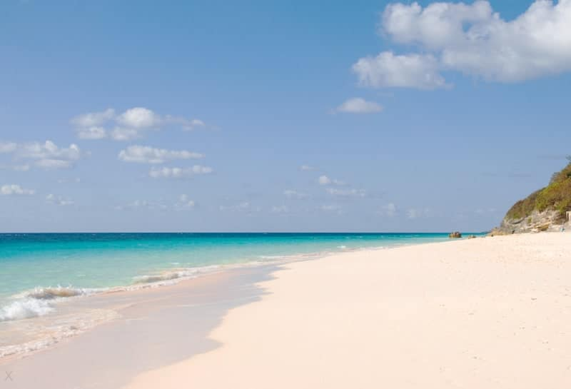 View of the pink sands and blue ocean at Elbow Beach in Bermuda