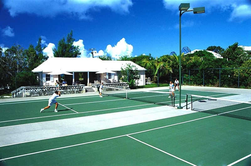 Players on the tennis courts at the Cambridge Beaches resort in Bermuda