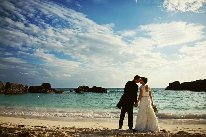 Married couple on the private beach at the Fairmont Southampton hotel in Bermuda