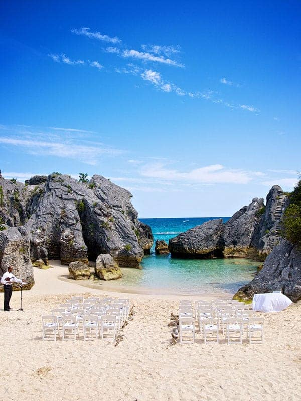 Chairs set up for a wedding ceremony on the beach at Jobson's Cove, Bermuda