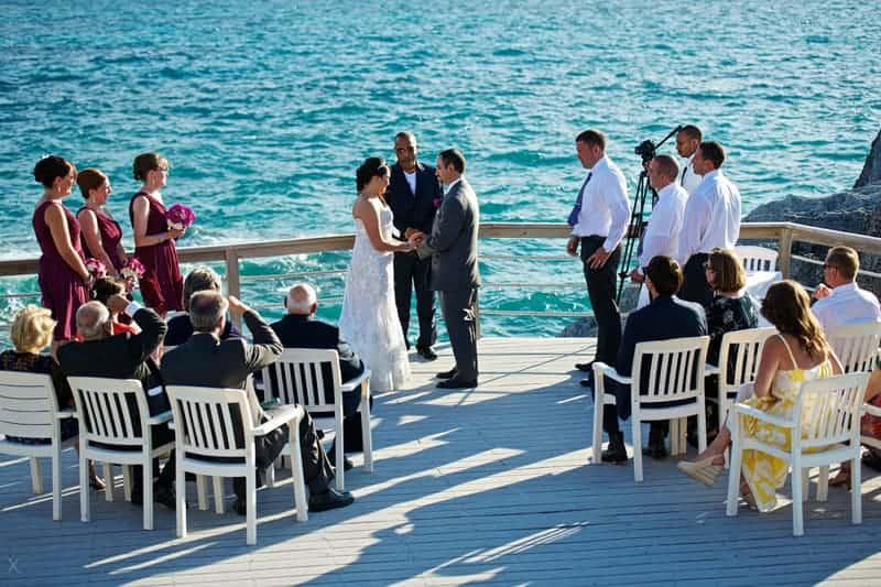 Minister conducting wedding ceremony at Caso's Point, The Reefs, Bermuda