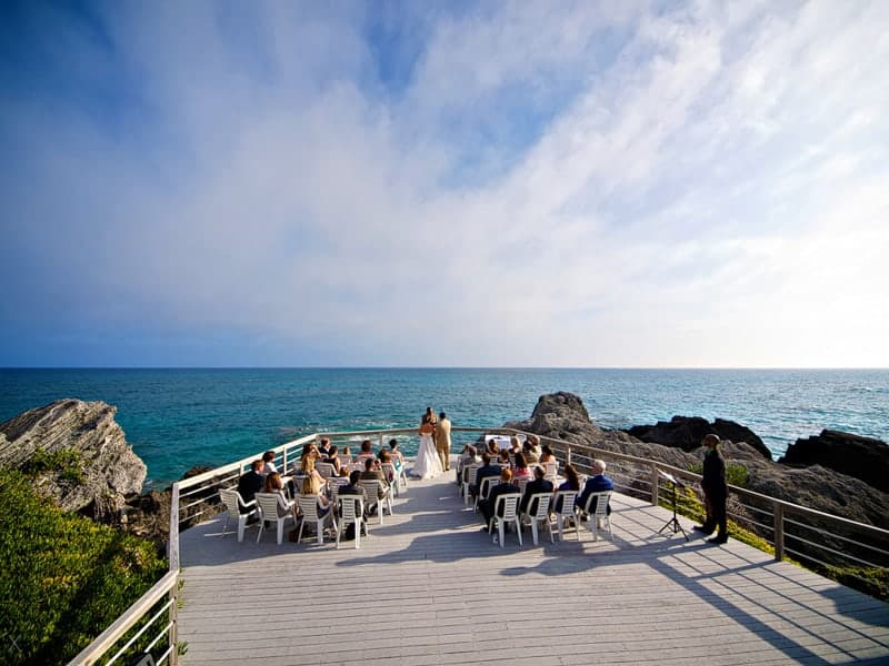 Wedding ceremony on the wooden deck, with view of the Atlantic Ocean