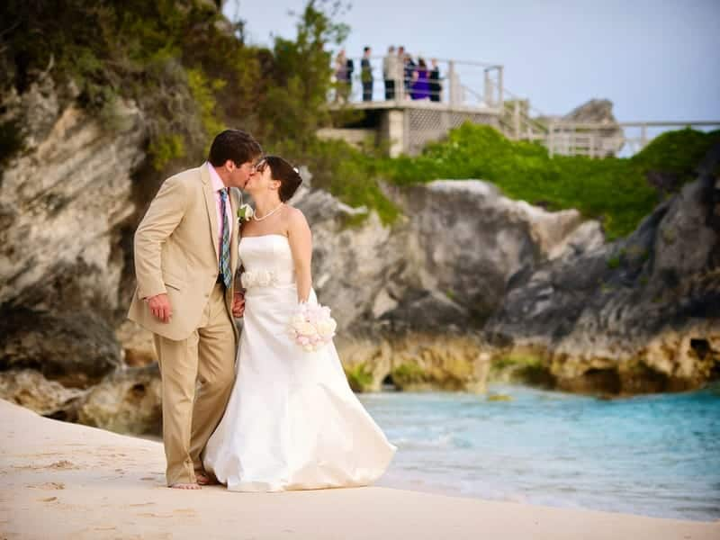 Bride and groom kissing on the beach at the Reefs, Bermuda