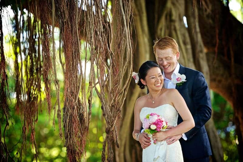 Bride and groom under a tree at the Botanical Gardens in Bermuda