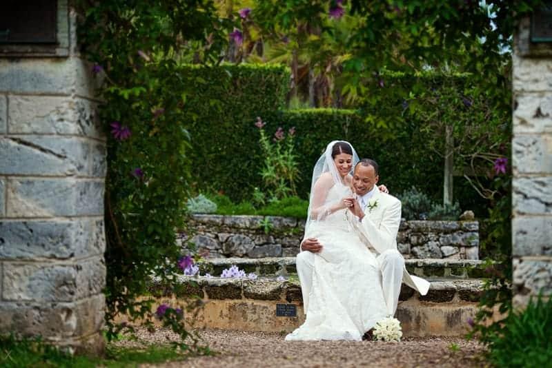 Groom admiring the bride's wedding ring