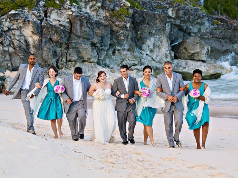 Wedding party walking on the beach at Rosewood Bermuda