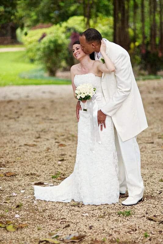 Groom kissing bride - photo shoot at the Bermuda Botanical Gardens