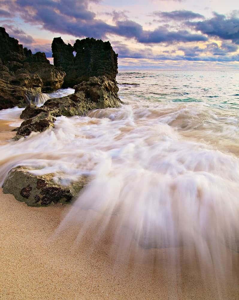 Waves crashing onto Church Bay Beach in Bermuda
